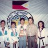 Taya with Grandmaster Sung Chon Hong, former Coach Dr Noli Gabriel and old team